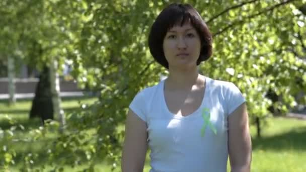Young woman with lime green awareness ribbon
