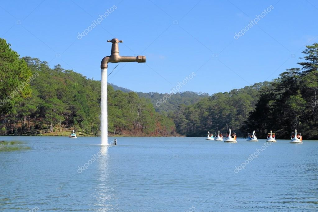 Free standing faucet floating over a lake