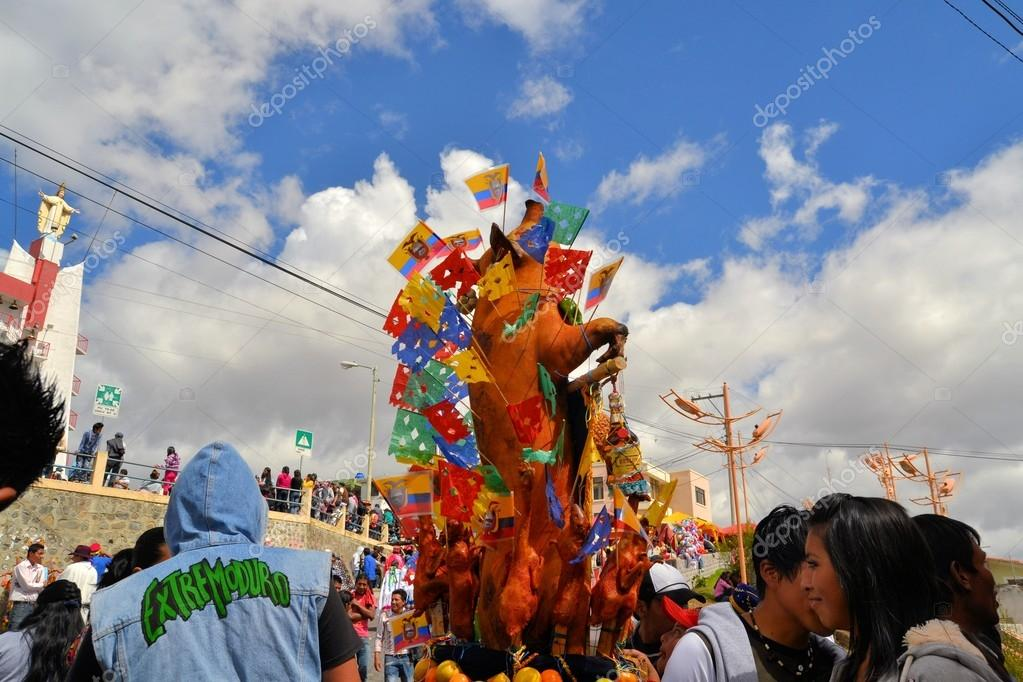 Pigs adorned with fruits, spirits, flags and guinea pigs at La Fiesta de la Mama Negra traditional festival
