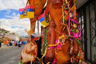 Pig adorned with fruits, spirits, flags and guinea pigs at La Fiesta de la Mama Negra traditional festival
