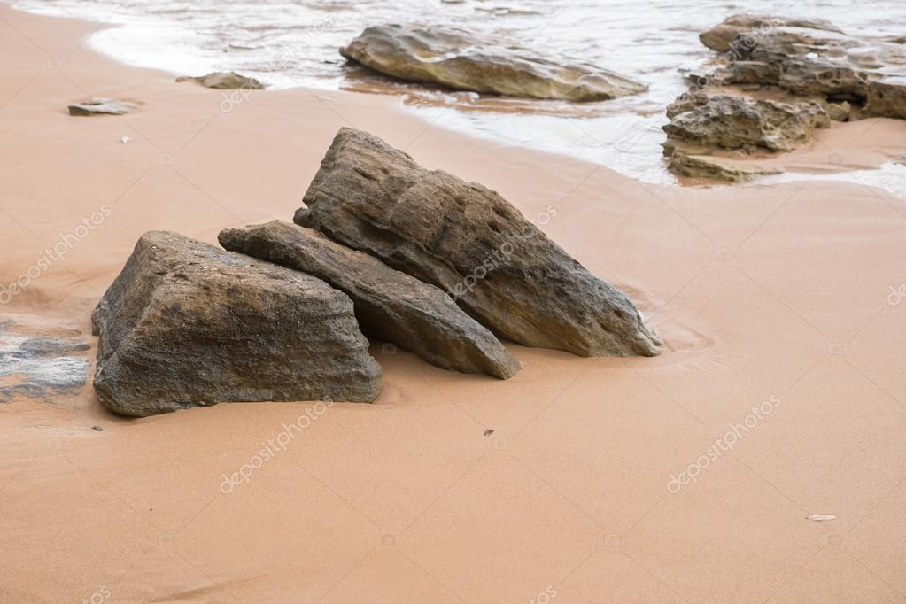 Kiezels op het strand u stockfoto kelifamily