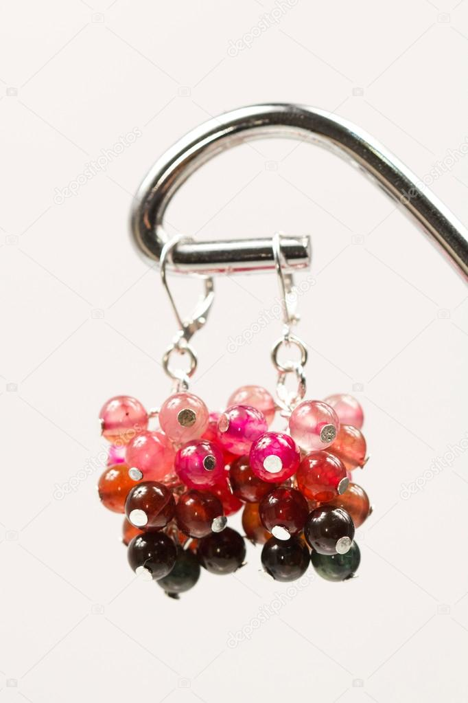 Silver jewels with colorful precious stones and light grey ...