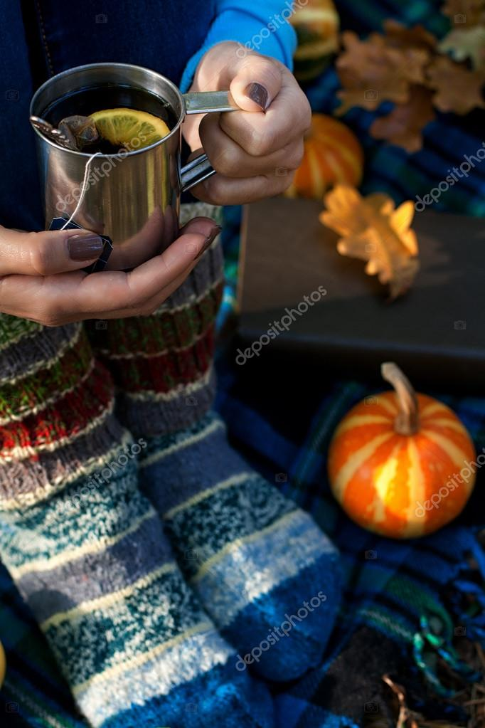 Female hands and legs on plaid background