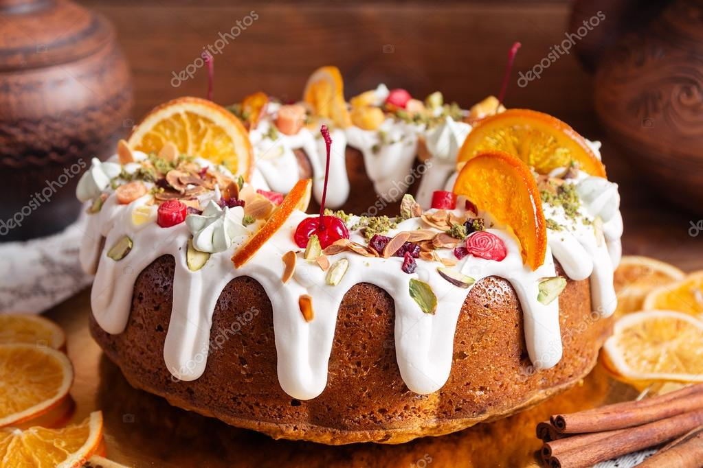 Decorated Bundt Cake On Rustic Background Stockfoto C Torriphoto