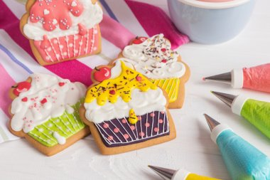 Colorful icing cookies in cupcake shape