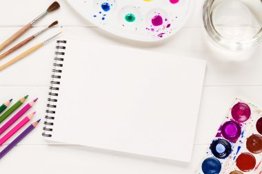 Mock up with artistic tools on white table