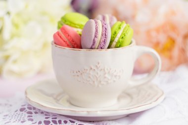 Colorful tiny macaroons in the cup