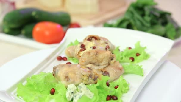 Roasted chicken legs stuffed with cheese