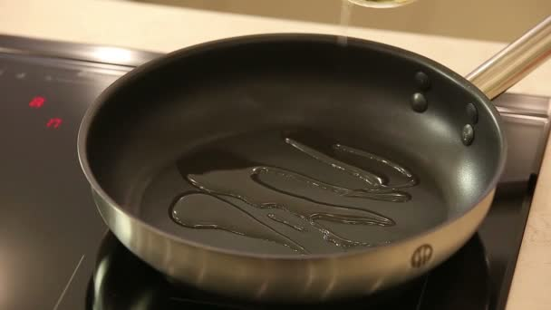Chef Puts Oil and Chicken Fillet on Black Frying Pan