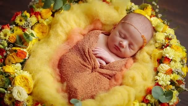 Cute little newborn baby girl sleeping in flowers