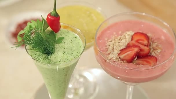 Presentation of Strawberry, Green Vegetables and Citrus Smoothies Decorated in Glasses