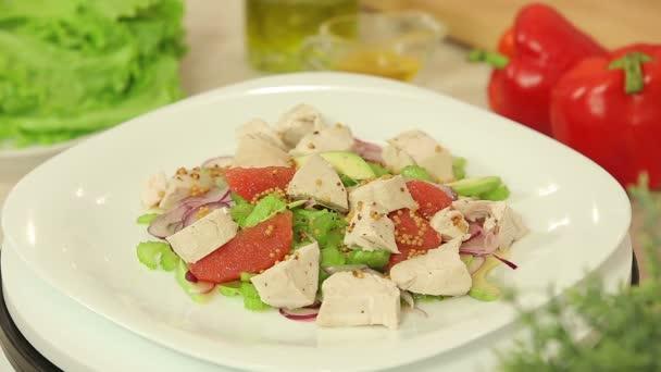 Fresh salad with orange and chicken fillet