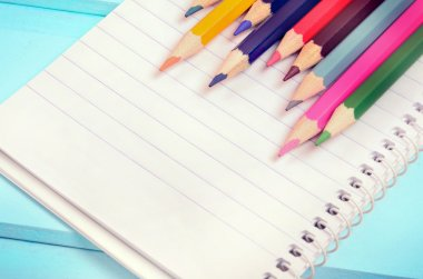 Colorful pencil with notepad