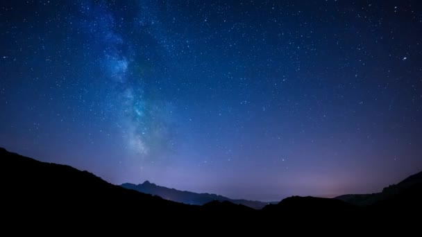 timelapse night sky stars milky way on mountains background. . Tuscany