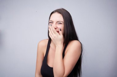 Beautiful brunette girl laughing