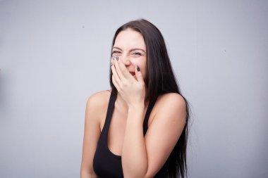 Beautiful brunette girl laughing
