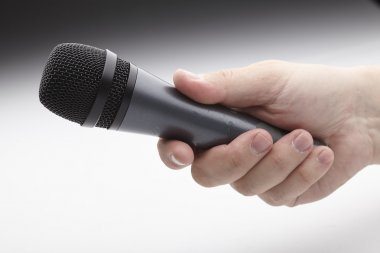 Microphone in man's hand