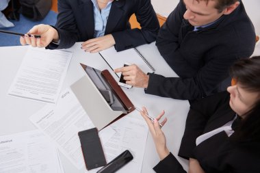 Three businesspeople working with tablet pc