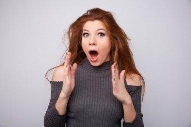 woman pleasantly surprised