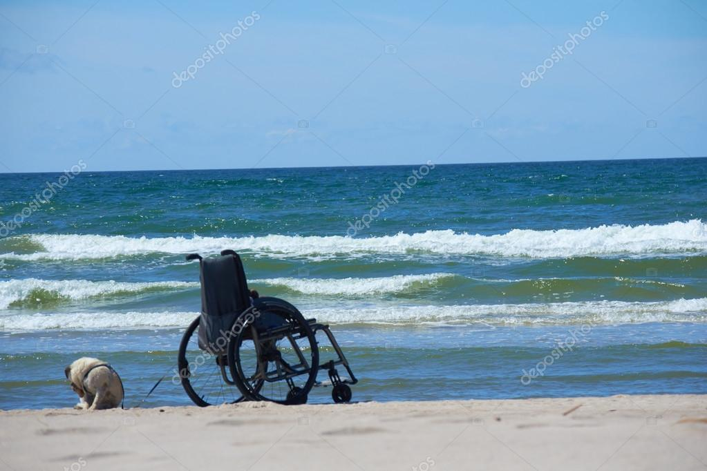 Wheelchair on tropical sea beach