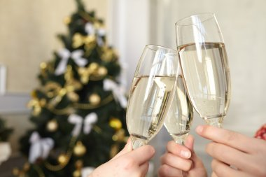Glasses of champagne in female hands