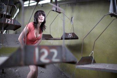 woman at abandoned factory