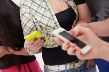 Students with mobile phones