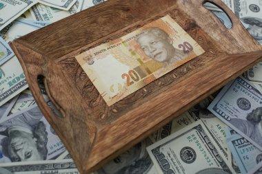 tray of twenty rand and dollars