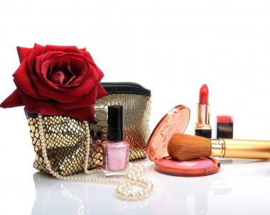 Cosmetic bag, makeup items, perfume and flowers in still life
