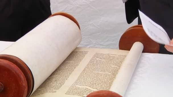 Hand of boy reading the Jewish Torah at Bar Mitzvah Bar Mitzvah Torah reading 5 SEPTEMBER 2016