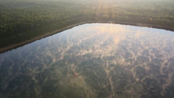 Mist over still water sunrise over lake