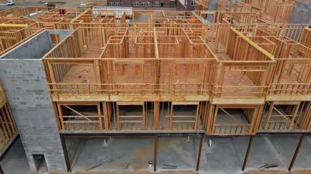 Wooden beam framing on urban apartment complex construction with wooden framework