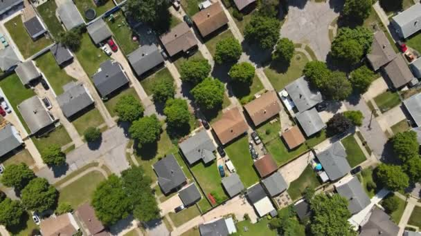 Aerial view of small town houses on road at landscape from above on residential area