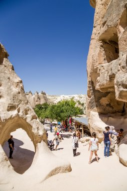 Cappadocia, Turkey. Tourists visiting monks' cells carved into the rocks in the Pashabag Valley (Monks Valley)