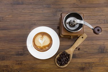Cup of coffee, coffee grinder and coffee beans