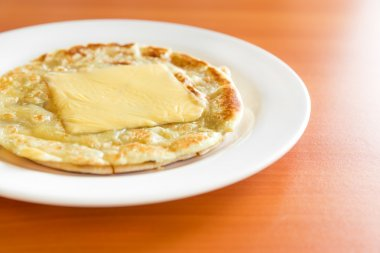 Roti prata with chesse on plate