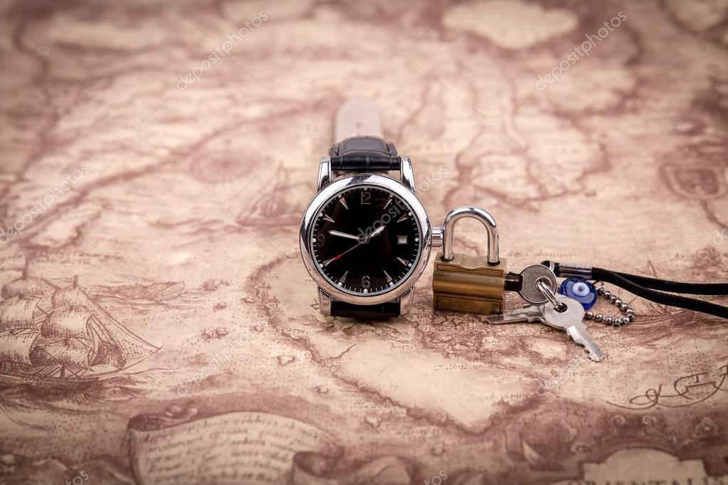 Antique background with map and watch stock photo dourleak watch on map background the lock with a key on world map photo by dourleak gumiabroncs Choice Image