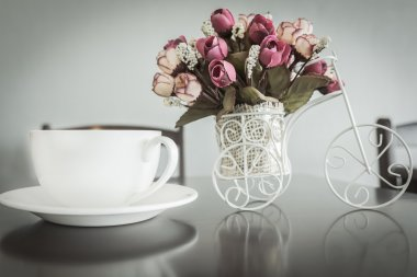 coffee and artificial flowers of modern