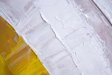 Photo showing the surface of the canvas covered with oil paint. Art, painting. Close-up.