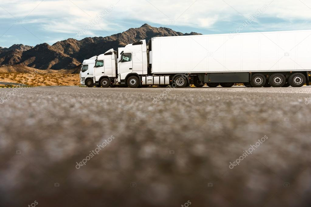 Three trucks in a row of a transporting company