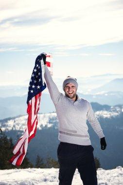 Young man holding USA flag