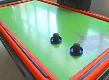 Air hockey table closeup with paddle