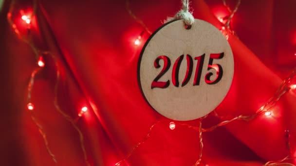 Capodanno 2015 - composizione di ghirlande su sfondo rosso