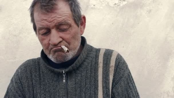 The poor man tries to light a cigarette handmade
