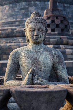 Ancient Buddha statue and stupa at Borobudur temple in Yogyakart