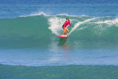 Surfer girl on the wave