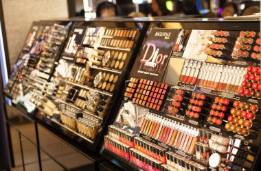 LONDON, UK - AUGUST 16, 2014: Harrods interiors with cosmetic products display