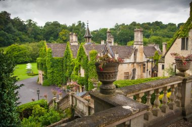 CHIPPENHAM, UK - AUGUST 9, 2014: Castle Combe, luxury house and gardens turned to be a hotel and golf club