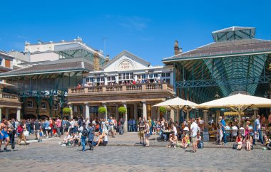 LONDON, UK - 22 JULY, 2014: Covent Garden market, one of the main tourist attractions in London, known as restaurants, pubs, market stalls, shops and public entertaining.
