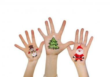 Children's hands raising up with painted Christmas symbols: Santa Claus, Christmas tree, Snow man,